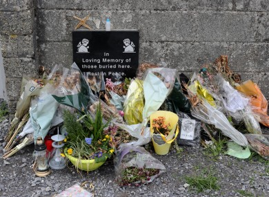 2017: Tributes left at the site of a mass grave for children who died in the Tuam mother and baby home.