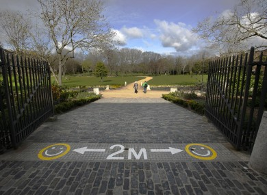 Painted social distancing signs on the entrance to Merrion Square in Dublin