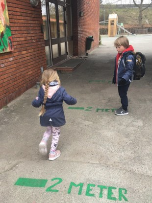 Children are greeted with strict social distancing requirements at a school outside Copenhagen.