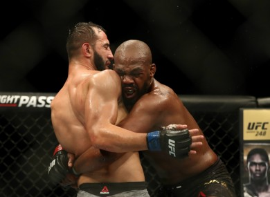 Dominick Reyes and Jon Jones (right) grapple at UFC 247.