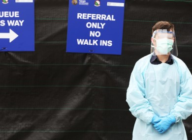 A man stands outside a test centre on John Rodgerson Quay, Dublin