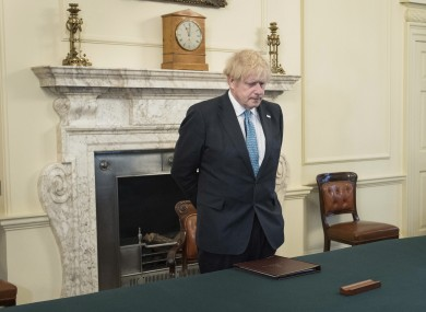 Britain's Prime Minister Boris Johnson pictured yesterday during a minute's silence to pay tribute to health service and key workers who have died during the coronavirus outbreak.