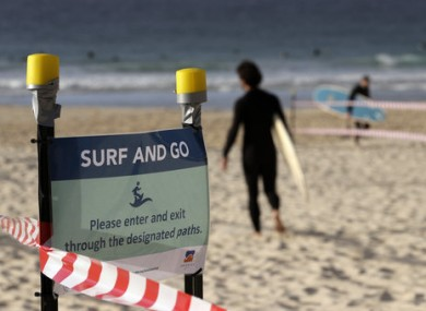 A sign tells surfers to leave once they have finished surfing at Bondi Beach in Sydney.