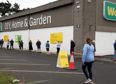 A queue of people outside Woodie's DIY store today in Glasnevin, Co Dublin.