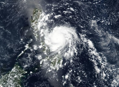 A satellite image released by NASA shows Typhoon Vongfong roaring toward the eastern Philippines.