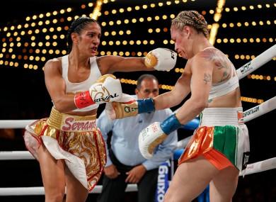 Amanda Serrano lands a left hand on Heather Hardy.