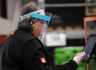 A B&Q worker in the Portrack Lane store in the UK