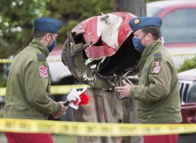 Canadian Forces Snowbird captains Erik Temple and Joel Wilson check out the crash scene.