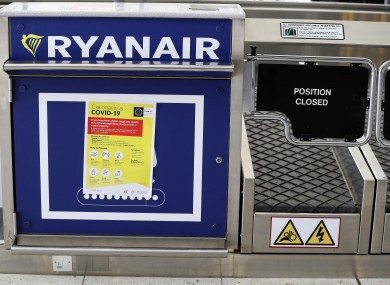 Coronavirus information at a Ryanair check in desk at Dublin airport.