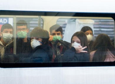 Teenagers wearing face masks on the London Underground (file photo)