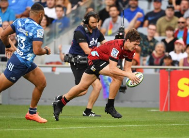 George Bridge scores for the Crusaders against the Blues before SUper Rugby was halted this year.