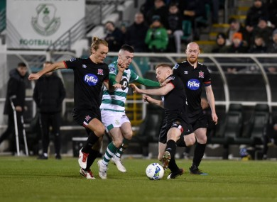 Jack Byrne of Shamrock Rovers with Greg Sloggett and Sean Hoare of Dundalk.