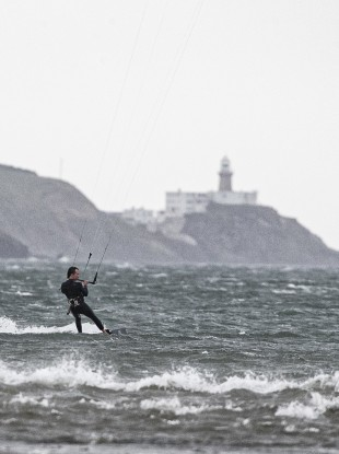 icardo Altieri from Dublin enjoying gusty winds off Bull Island, Dublin this afternoon.