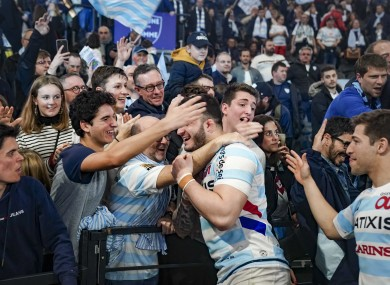 Teddy Baubigny of Racing 92 celebrates with fans in February: Paris club sit third in abandoned Top 14 table.