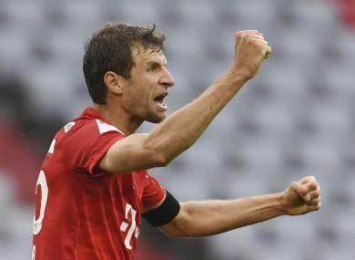 Thomas Muller celebrates scoring Bayern's second goal.