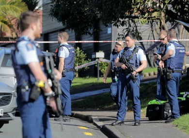 Police officers pictured near the scene today.