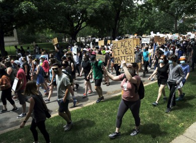 People march from the governor's mansion in St. Paul, Minneapolis on Saturday