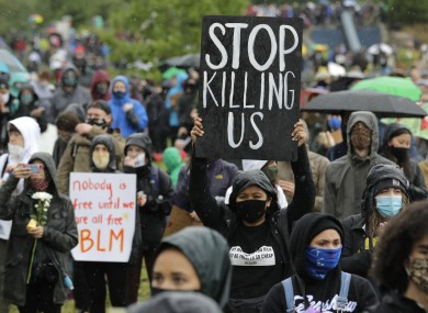 A protester holds a sign that reads