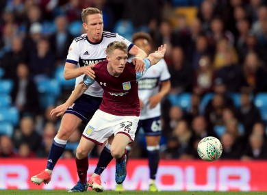 Jake Doyle-Hayes under pressure from Adam Forshaw during a Carabao Cup game between Aston Villa and Middlesbrough in September 2017.