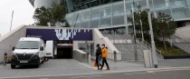 People walk past an entrance to Spurs' home ground.
