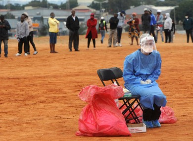 A medic waits for a patient to test for Covid-19 in the Alexandra township in South Africa.