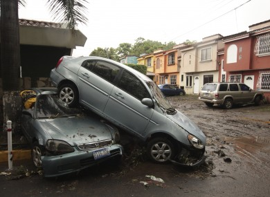 Vehicles stand damaged by an Acelhuate River flash flood at a neighborhood in San Salvador, El Salvado