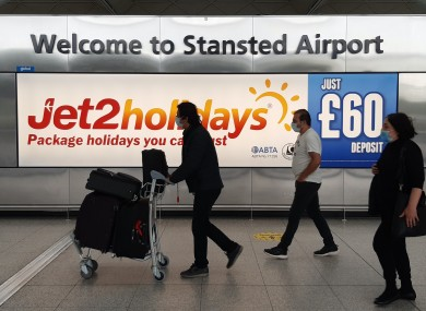 Passengers at Stansted Airport in England.