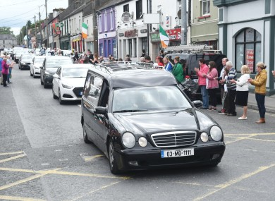 The hearse with the body of Detective Garda Colm Horkan arriving in Ballaghaderreen in Co Roscommon