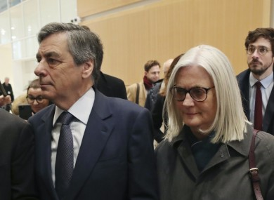 France's former prime minister Francois Fillon, left, and his wife Penelope, arrive at the Paris courthouse, in Paris