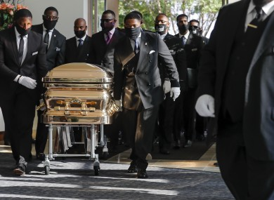 Pallbearers bring the coffin of George Floyd into a church in Houston ahead of his funeral