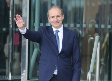 Martin leaving the Dublin Convention Centre after being elected taoiseach yesterday.