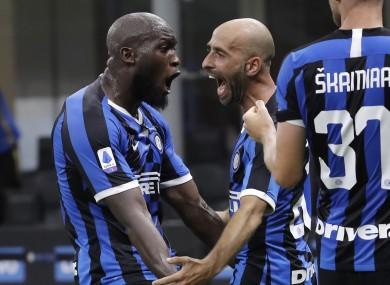 Inter Milan's Borja Valero, centre, celebrates with his teammates Romelu Lukaku, left, and Milan Skriniar after scoring his side's third goal.