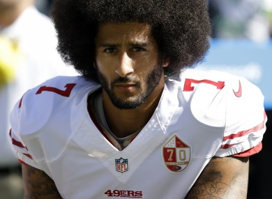Colin Kaepernick protests ahead of a game in 2016.