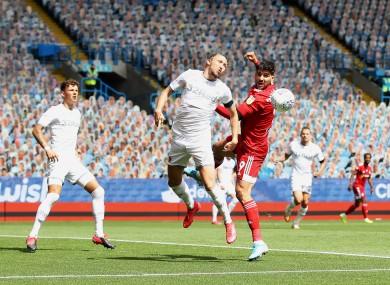 Mitrovic (right) and Leeds United's Luke Ayling on Saturday.