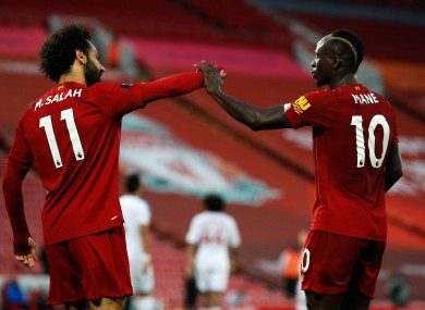 Salah and Mane celebrate Liverpool's fourth goal.
