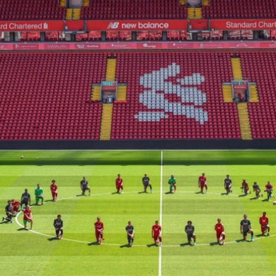 Liverpool's first-team squad take a knee at Anfield.