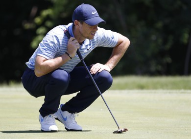 Rory McIlroy lines up a putt on the 11th green during the third round of the Charles Schwab Challenge.