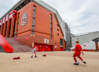 James Ryan-Byrne (red kit) and Ethan Potsig, both aged nine, play football outside Anfield.