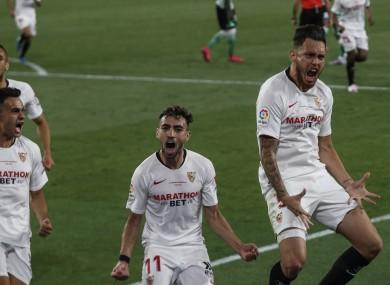 Sevilla's Lucas Ocampos celebrates after scoring against Real Betis.