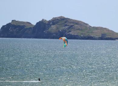 A kitesurfer in the sea off Portmarnock Beach in Dublin on Friday