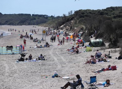 Crowds on Brittas Bay beach, Co Wicklow, where Gardai have turned away non-locals who are trying to visit.