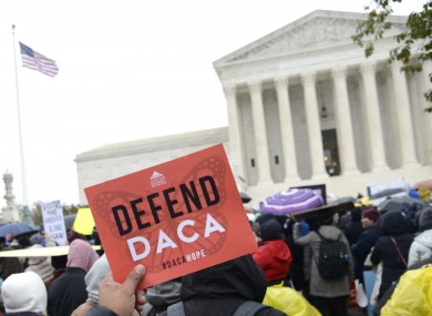 Pro-immigration demonstrators outside the US Supreme Court in Washington DC in October 2019