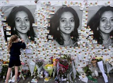 Messages in memory of Savita Halappanavar at a mural in 2018.