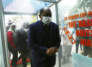 Zimbabwe's health minister, Obadiah Moyo, arriving at court in Harare today