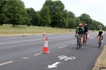 Cyclists last month using a bicycle lane in the Phoenix Park Dublin in place where cars used to park.