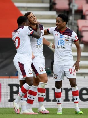 Michael Obafemi celebrating with his Southampton team-mates.
