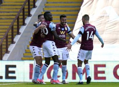 Aston Villa's Trezeguet (third left) celebrates scoring.