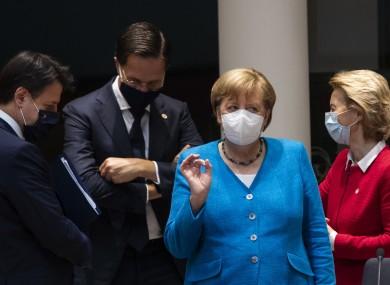 German Chancellor Angela Merkel speaks with (from left) Italy's Prime Minister Giuseppe Conte, Dutch Prime Minister Mark Rutte and European Commission President Ursula von der Leyen