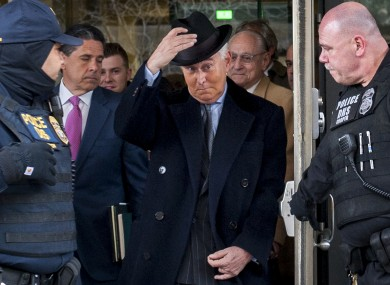 Republican strategist Roger Stone leaves federal court following his sentencing to 40 months in prison.