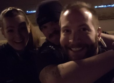 The photos showed the officers grinning as they re-enacted the chokehold